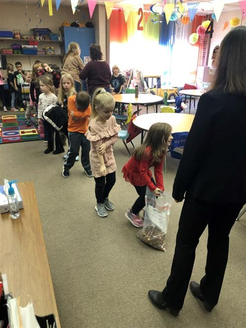 First Grade Participates In Christmas Tree Building STEM Activity!