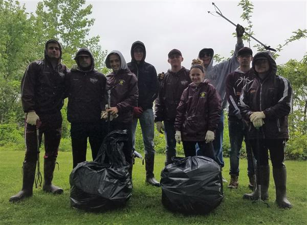 CONSERVATION CLUB: Members of the Conservation Club braved the cold and rain to clean up the riverfront on 5/13/19
