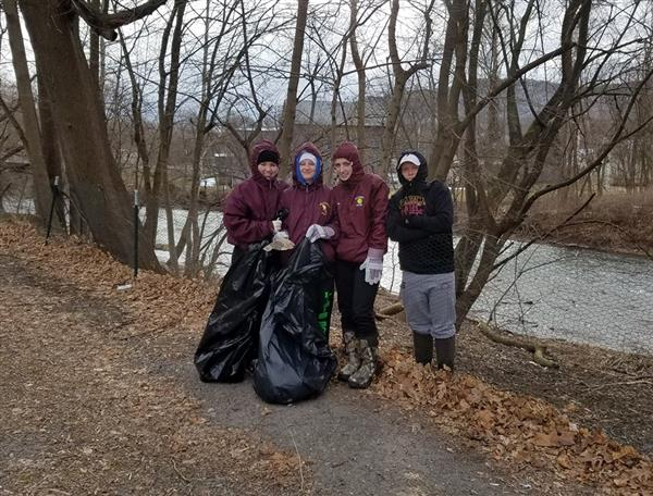 The member of Conservation Club braved the cold temperatures on March 15 to stock the Wiconicso Creek and clean up the riverfront