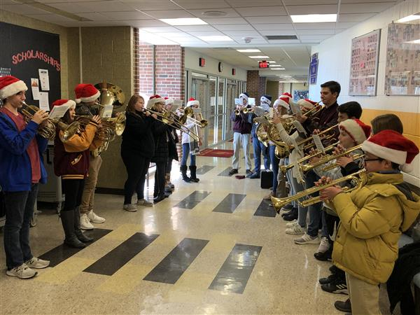 12/19/19: BRASS CAROLING: We're so very proud of our members of the band who braved the frigid temperatures today to spread holiday cheer throughout our community!
