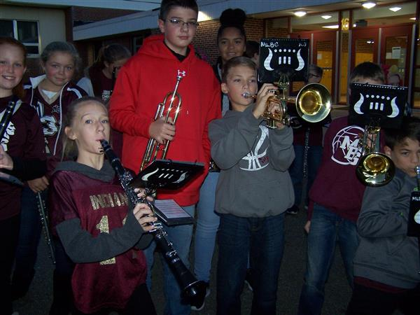 Middle School Band members enjoyed playing with the HS Band during a home football game