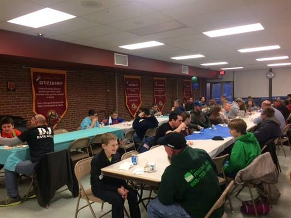 "On March 16, Middle School Student Council sponsored the first-ever ""Dads-N-Donuts.""  It was a huge success!!"